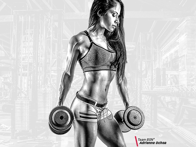 Female fitness model holding weights