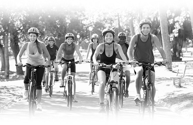Group of young people biking