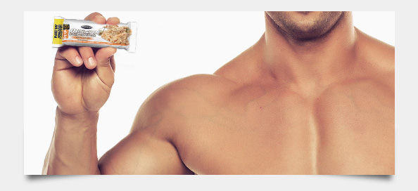 Photo of model holding protein bar