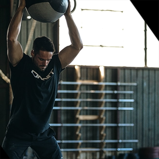 Onnit athlete working out with a medicine ball