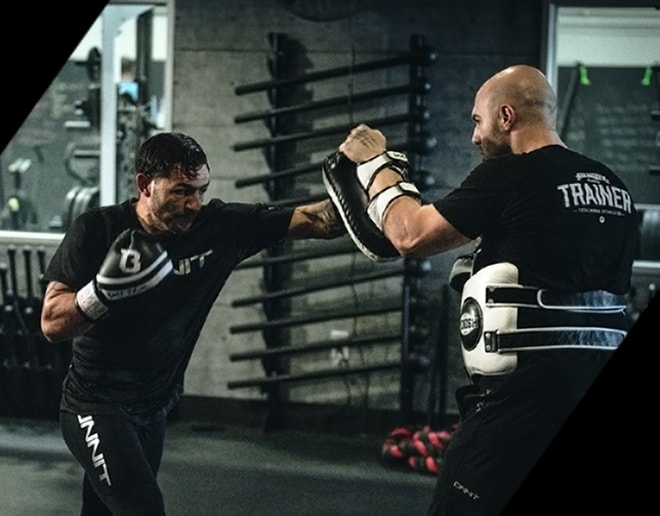 Onnit athlete kickboxing in the gym