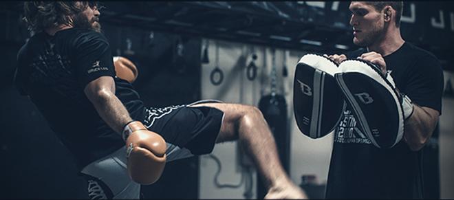 Kickboxer training in gym