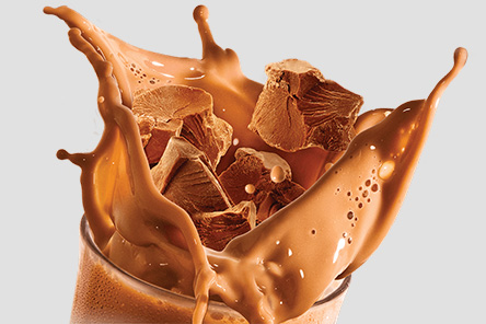 Chocolate splashing in cup