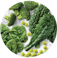 Photo of spinach, broccoli and peas.