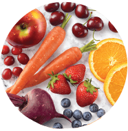 Photo of carrots, strawberries, orange slices, apples and other fruits.